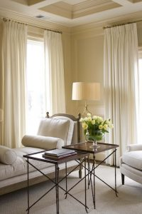 Hanging long curtains just below the ceiling that sweep all the way down to the floor is like putting stiletto heels on a room. Ceilings instantly look higher. hanging floor-to-ceiling curtains is another way on how to make a small room look bigger