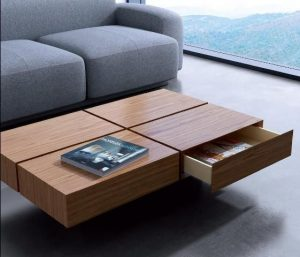 This coffee table is for storing all of TV components . use lots of baskets for holding chew toys for dogs and blankets. If everything you use can be tucked in a designated spot out of the way, you eliminate clutter and give the appearance of space. utilize hidden storage and multi-use furniture to make a small room look bigger