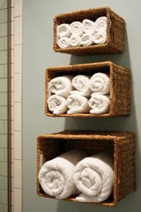 How to Organize your bathroom ideas like this are genius! Turn your baskets on their side for your towel storage. Using baskets for wall storage in the bathroom