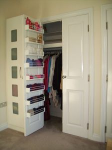 Use the cabinet and closet doors for storage.