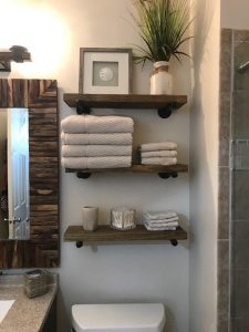 How to organize your bathroom include the use of floating shelves.