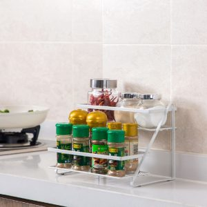 How to organize your bathroom can be achieved using spice racks. Grab some inexpensive spice racks and hang them on a bathroom wall and you've got instant shelving.